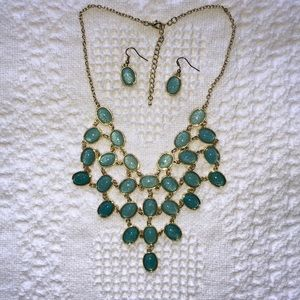 Gold and green tiered necklace and earrings